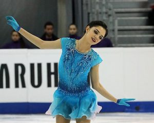 A Russian figure skater returns to Russia from Canada